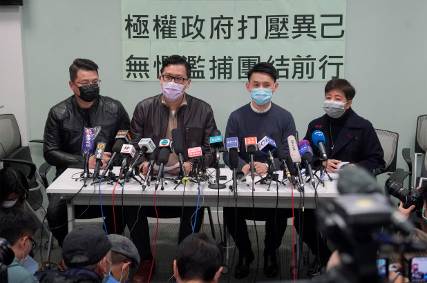 Former Democratic lawmakers Andrew Wan, left, Lam Chuck Ting, second from the left, and Helena Wong, right, at a news conference after they were released on bail.